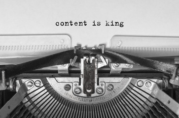 content is king typed words on a vintage typewriter. Close-up.