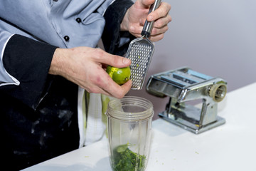 The chef prepares and serves green lemon
