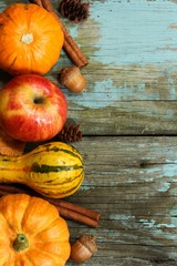Rustic Autumn background with pumpkins apples and fall spices