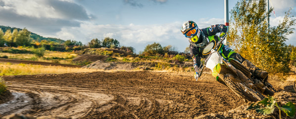 Foto op Aluminium Motorsport Extreme Motocross MX Rider riding on dirt track