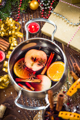 Spices and mulled wine in pot