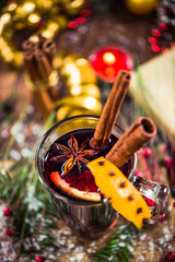 Red mulled hot wine in glass with spices