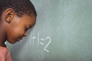Student leaning on chalkboard