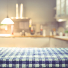 Checkered tablecloth texture top view with blur kitchen room background.For montage product display or design key visual