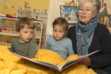 Grandma Reads Book to Grandchildren 2