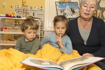 Grandma Reading Book to Grandchildren 3