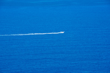 A motor boat going on high speed in blue sea
