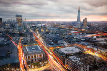 City of London at sunset and traffic blur lights on busy roads. Technology, transformation and innovation idea.