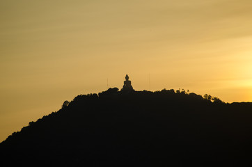 Phuket big buddha on top hill with sunset