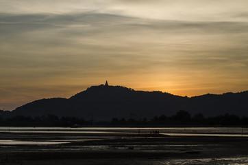 Phuket big buddha on top hill with sunset