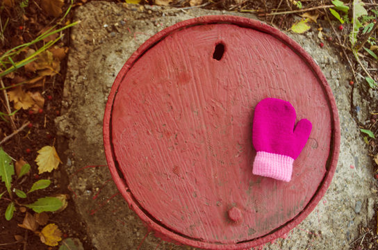 lost baby mittens on manhole