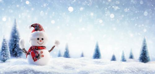 Snowman In Wintry Landscape Wall mural