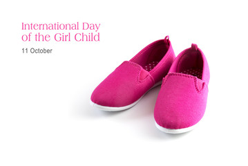 pink kid shoes isolated on a white background, text  International day of the girl child, 11 October, copy space