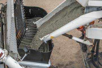 construction site pouring concrete. Concrete pouring into a concrete pumping in construction site