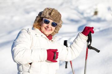 Happy female skier in sunny day