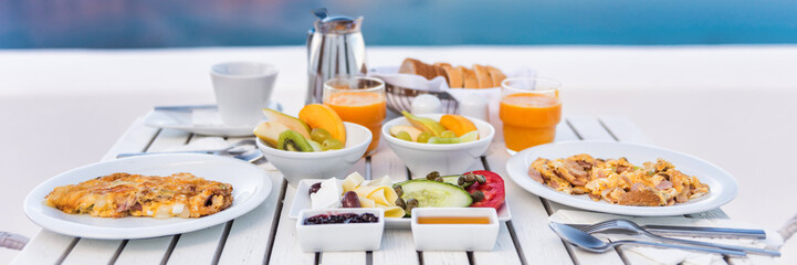 Breakfast brunch table fruits and omelettes for couple honeymoon at restaurant. Cruise vacation...