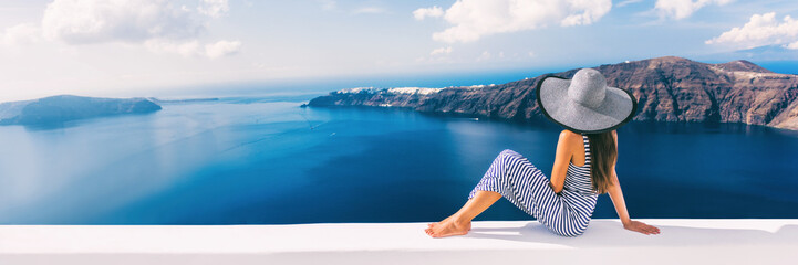 Wall Mural - Travel luxury cruise vacation holiday woman panoramic banner. Sun hat maxi dress woman relaxing at sea view in Santorini, Oia, Greece. Europe destination.