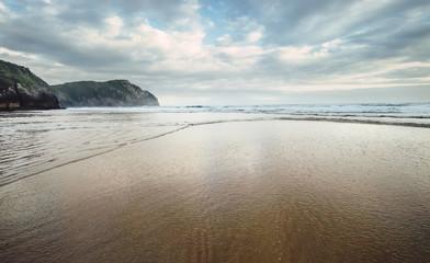 Ocean waves on the sand beach, Northern Spain