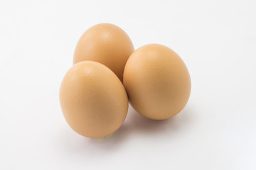 Eggs stand on white background