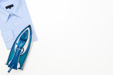 Blue iron and shirt on ironing board