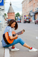 beautiful european woman with guitar