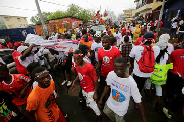 Suporters of Alexander Cummings, presidential candidate of the Alternative National Congress (ANC), arrive for a meeting during their party's presidential campaign rally at the Antoinette Tubman Stadium in Monrovia