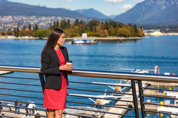 Businesswoman taking coffee break at Vancouver city harbour. Canadian Asian Chinese business woman drinking coffee enjoying coffee break at nature landscape view. Businesspeople modern lifestyle.