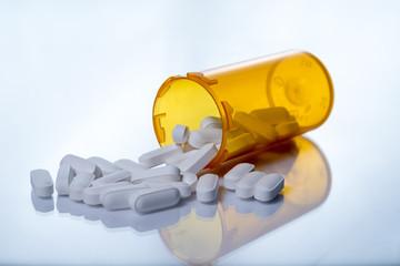 White pills and prescription bottle