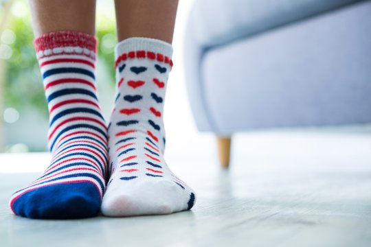 Low section of girl wearing patterned socks