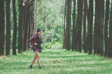Hipster  traveler with backpack walking