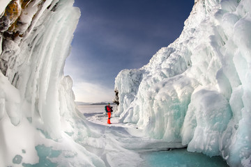 Man between the ice rocks on Lake Baikal on a clear day