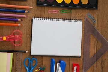 Various school supplies on wooden table