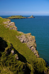 Worms Head and cliffs on the southern end of Rhossili Bay near Swansea in Wales, UK
