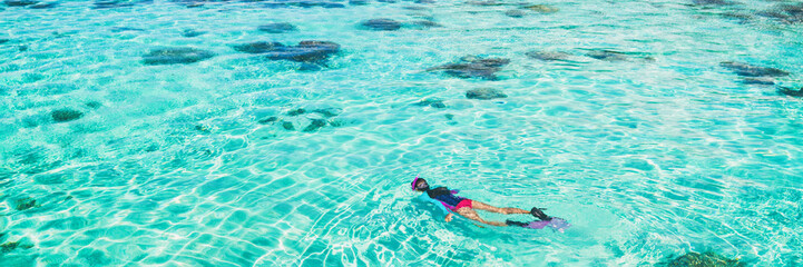 Wall Mural - Vacation tourist snorkel woman swimming snorkeling in paradise clear water banner panorama. Swim girl snorkeler in crystalline waters and coral reefs. Turquoise ocean background.