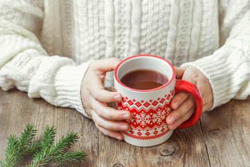 Hot chocolate in hands