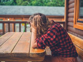 Sad and tired woman on porh