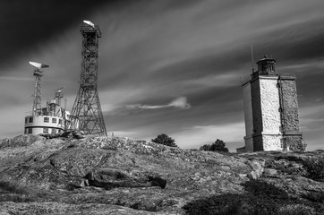 Military structures radar tower and old tall lighthouse in the archipelago Finland Nordic Europe