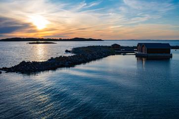 Sun reflecting in the still water near the Jurmo island in Finnish archipelago