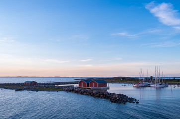 Jurmo island during the sunset red wooden boat storage