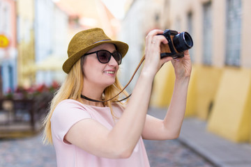 travel and photography concept - young woman tourist with camera