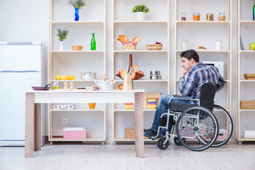 Disabled young man husband working in kitchen