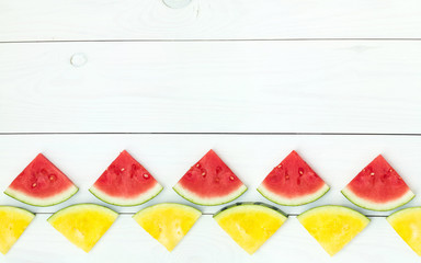 Red and yellow watermelon slices on sticks