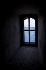 Dark view thought the small window inside the Soderskar lighthouse in Finland Europe