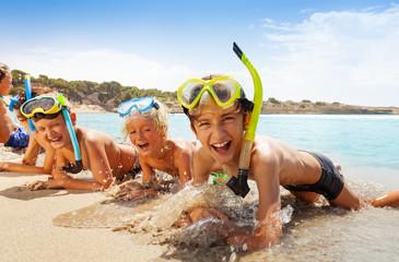 Happy screaming boys in scuba mask on the beach