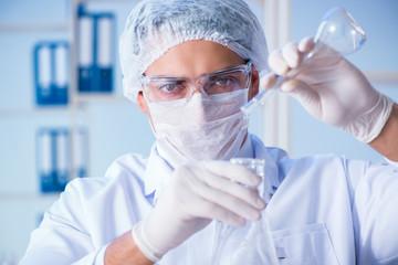 Female scientist researcher conducting an experiment in a labora