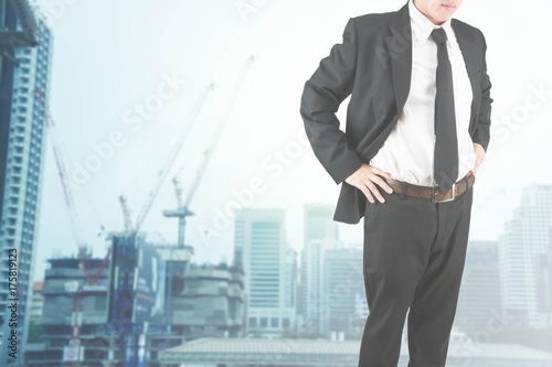 2c24e4950fe50 Double exposure businessman on blur view of the building city background