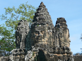 Stone faces over the East City Gate, Anglor Wat, Siem Reap, Cambodia