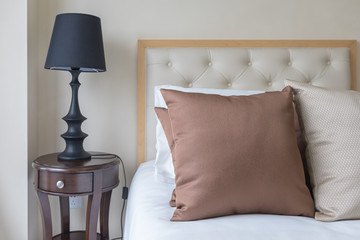 set of brown pillows on bed in classic bedroom