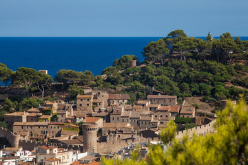 View of the old town of Tossa de mar one of the most beautiful city on the Costa Brava. City walls and medieval castle on the hill. Amazing city in Girona, architecture and monuments of Catalonia.