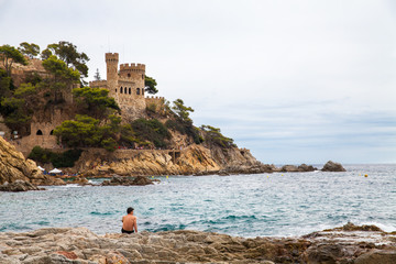 Castell d'en Plajan on the Costa Brava in Lloret de Mar, Spain. View of the Balearic Sea and the rocky coast. Popular tourist destination in Spain.